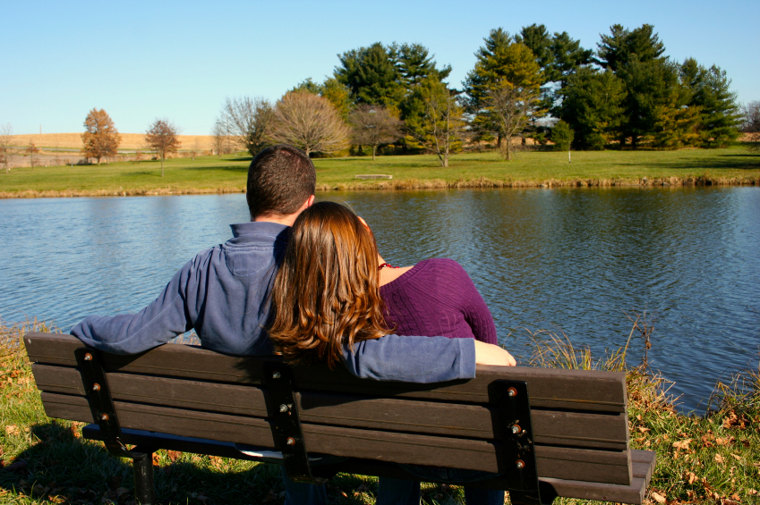 Young couple on park bench